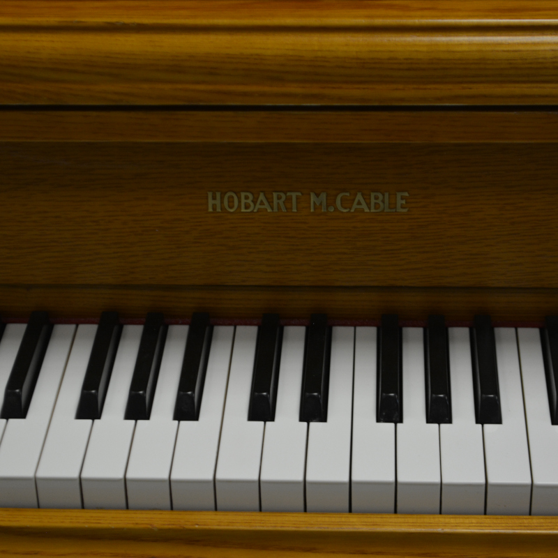 Hobart M. Cable Upright Piano - French Oak